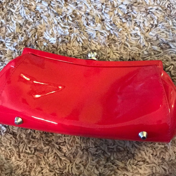 La Regale Handbags - Red patent leather clutch